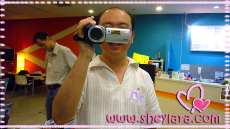 [Michael is very pleased with his new camera]